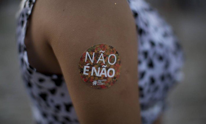 x74698023_In-this-Feb-3-2018-photo-a-woman-sports-a-sticker-on-her-arm-that-reads-in-Portuguese-No27-i.jpg.pagespeed.ic.neIZaX3r6v